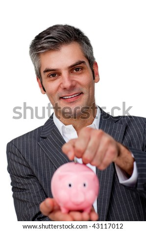 Self-assured Businessman saving money in a piggybank against a white background - stock photo