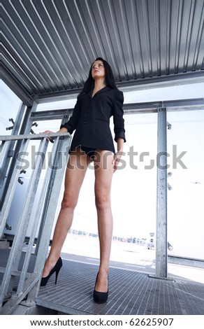 Self assured independent  woman  standing picture from bellow - stock photo
