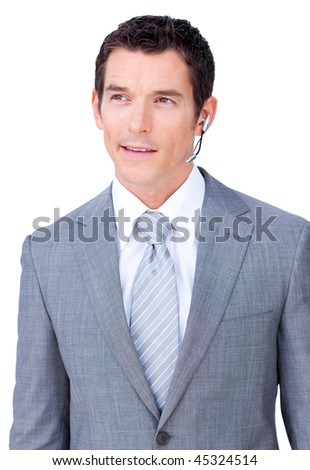 Self-assured male executive with headset on against a white background - stock photo