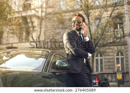 Self-confident businessman - stock photo