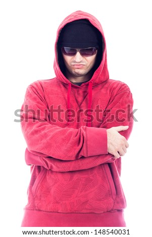 Self-confident hip-hop style man in red hoodie and sunglasses, isolated on white background.