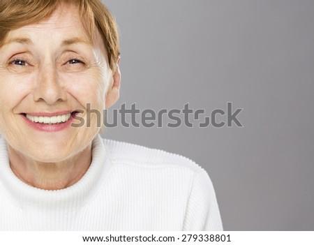 Self confident senior woman smiling - stock photo