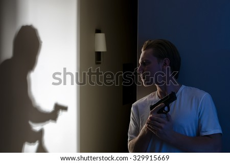 Self Defense Concept - Homeowner Ready to Fight Armed Robber - stock photo