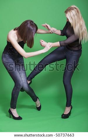self defense technique in martial arts - low kick - stock photo
