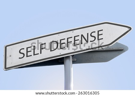 SELF DEFENSE word on road sign
