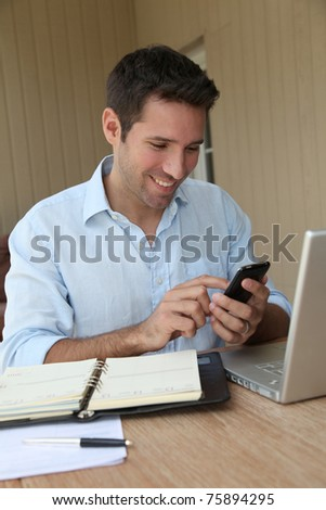 Self-employed person working from home - stock photo