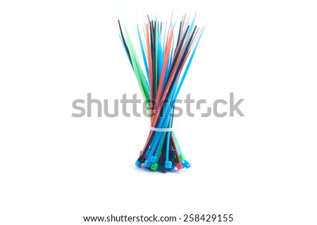 self-locked plastic zip cable ties in different colors over white background