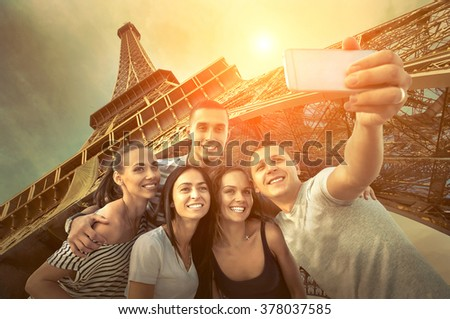 Self of Group friends on the one of the most popular travel place in world - Eiffel Tower. - stock photo
