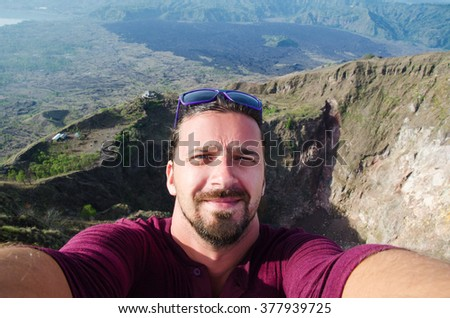 Self-portrait of a handsome young hiker - stock photo