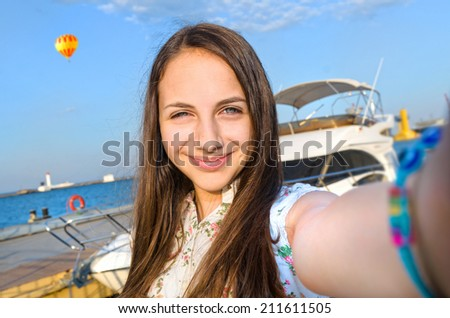 Self-portrait of a young beautiful woman - stock photo