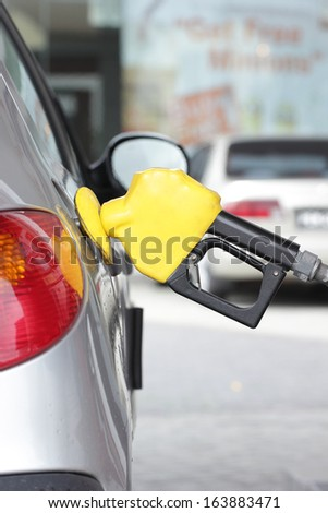Self service FUEL Pump in oil station - stock photo