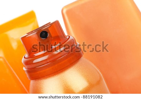 Self tanning spray and tubes, closeup on white - stock photo