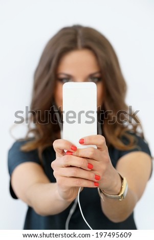 Selfie. Curly woman with mobile phone - stock photo