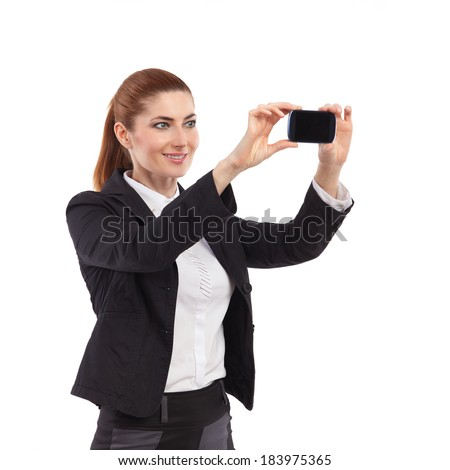Selfie. Elegance woman taking self portrait with smart phone. Waist up studio shot isolated on white. - stock photo