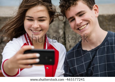 Selfie - girl and boy taking photo
