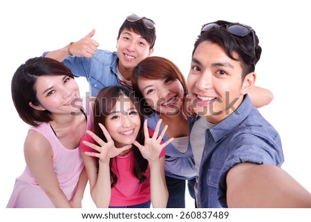 Selfie - Happy teenagers taking pictures by themselves isolated on white background, asian - stock photo