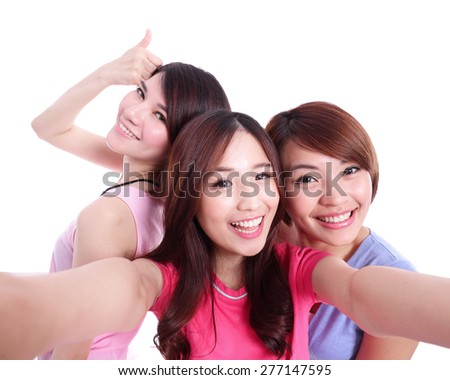 Selfie - Happy teenagers woman taking pictures by themselves isolated on white background, asian - stock photo