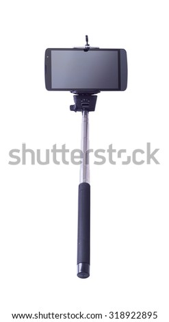 selfie monopod and cellphone . Isolated on white background .