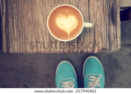 Selfie of coffee with shoes - stock photo