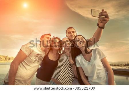 Selfie of grop happiness friends under sunlight. - stock photo