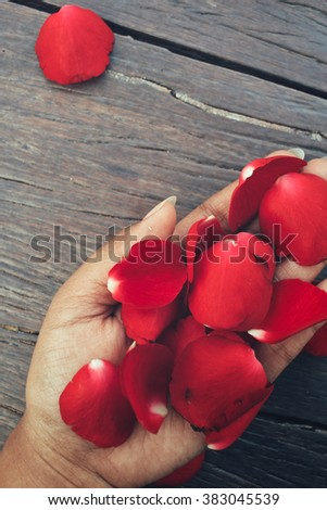 Selfie of petals red roses with hand