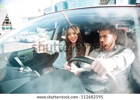 Selfie of pretty couple in car. so nice image