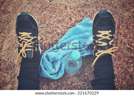 Selfie of sport shoes with water drink