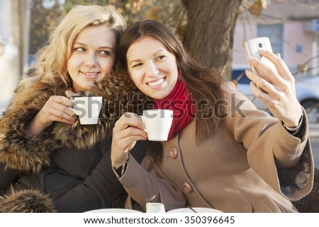 selfie  of young beautiful girls on the phone