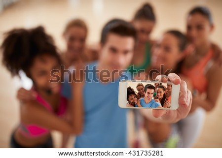 Selfie of young fitness group, close up of mobile phone