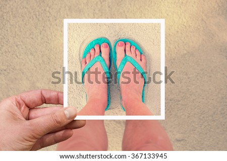 Selfie photo of woman feet wearing flip flops on a beach, vintage process - stock photo