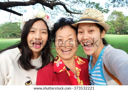 Selfie Senior woman with daughters - stock photo