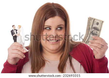 Selfish woman holding a wedding figurine and some dollar banknotes. - stock photo