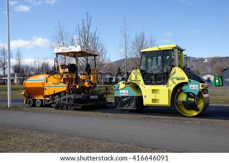 SELFOSS, ICELAND - MAY 4 : Asphalt paver machine and heavy machinery during repairs road under the program repairs highway road on May 4, 2016 in Selfoss, Iceland. - stock photo