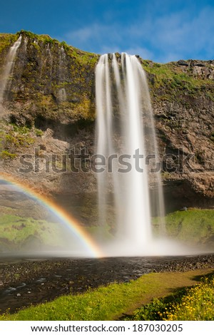 Seljalandsfoss is one of the most beautiful waterfalls on the Iceland. It is located on the South of the island. With a rainbow - stock photo
