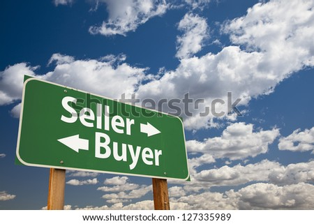 Seller, Buyer Green Road Sign Over Dramatic Clouds and Sky. - stock photo