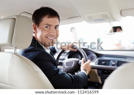 Seller in a car in a motor show - stock photo