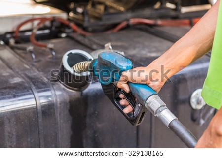 Seller refill oil for a car.small business of fuel pump and  old equipment