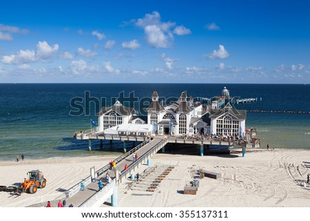 Sellin,Germany - September 26,2015:Pier with historical house. A famous tourist attraction on the island of Ruegen. - stock photo