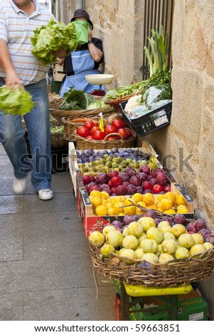 selling fruits and vegetables at a street market - stock photo