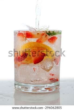 Seltzer Drink with Fresh cut fruit floating inside