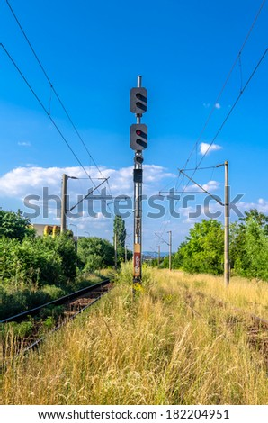 Semafor is an electrical device that indicates to train drivers information about the state of the line ahead, and therefore whether he must stop or may proceed - stock photo