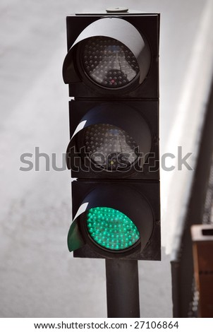 Semaphore in the street. Green color on - stock photo