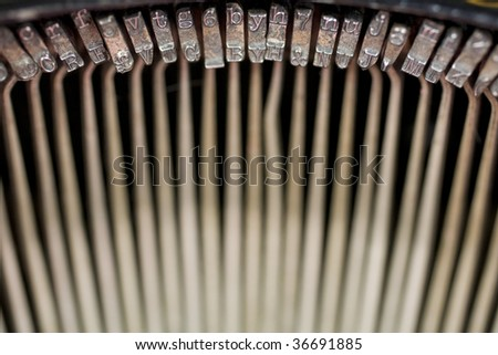 Semi-abstract view of the key strikes (key bars) inside an old fashioned typewriter, of the 1900-1920 era. Photo has been flipped horizontally in Photoshop. - stock photo