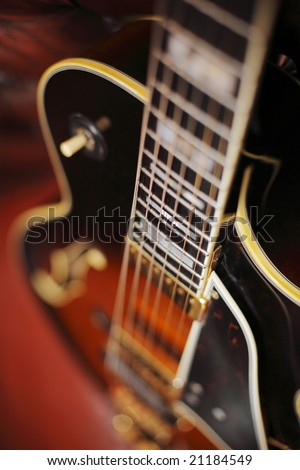 Semi-acoustic jazz electric guitar in closeup. Short depth of field - stock photo