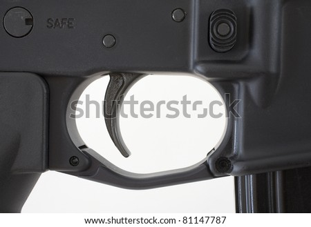 Semi automatic assault rifle with its safety engaged near the trigger - stock photo