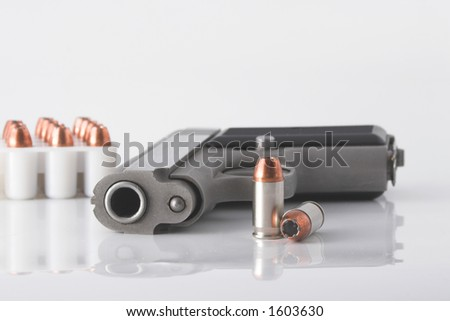 Semi automatic handgun and pistol cartridges - stock photo