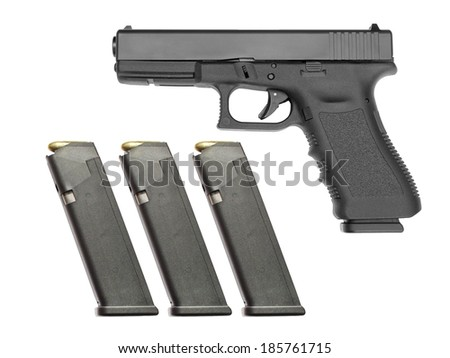 Semi automatic handgun with three full magazines on white background. Each magazine filled with 17 rounds. - stock photo