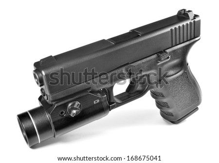 Semi-automatic pistol with attached flashlight - stock photo