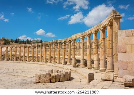 Semi-circle of columns forming a plaza at the ancient ruins of Jerash in Jordan. - stock photo