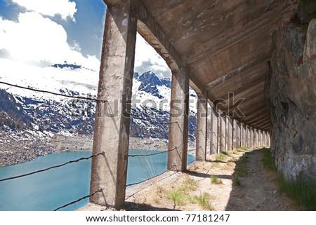 Semi indoor tracks along Arno man-made lake basin at 1900 meters on the sea-level. Brixia province, Lombardy region, Italy - stock photo